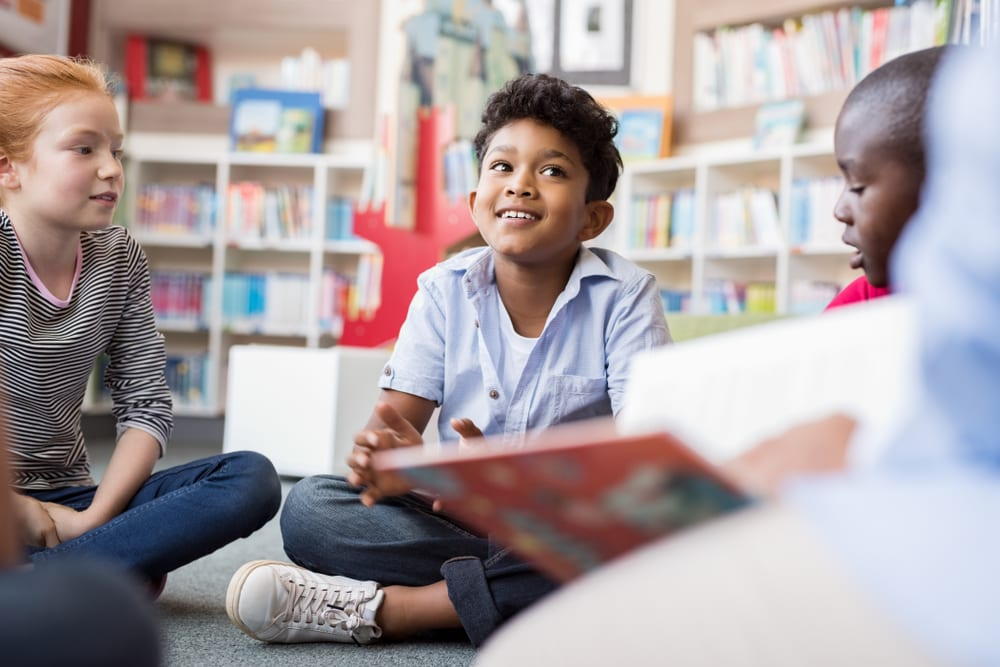 Young boy in a classroom reading circle